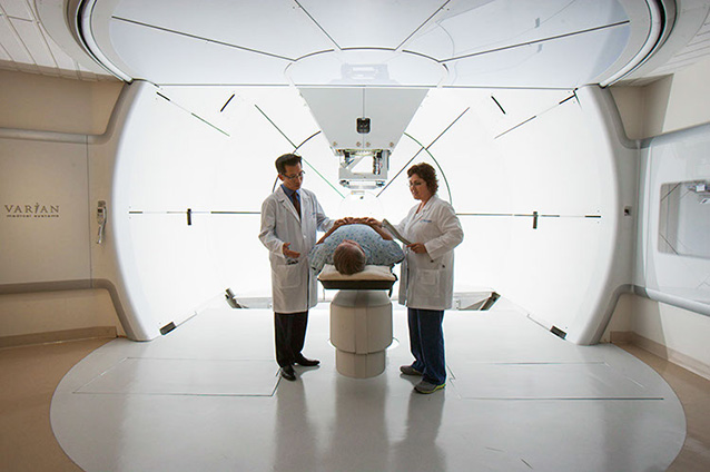 Gantry with Dr. Giap and patient: Scripps Proton Therapy Center treats patients exclusively with the latest generation of proton beam technology.