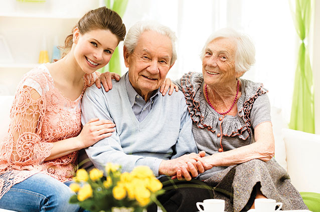 iStock 000036003438 Double elderly couple man woman happy daughter sitting smiling 1